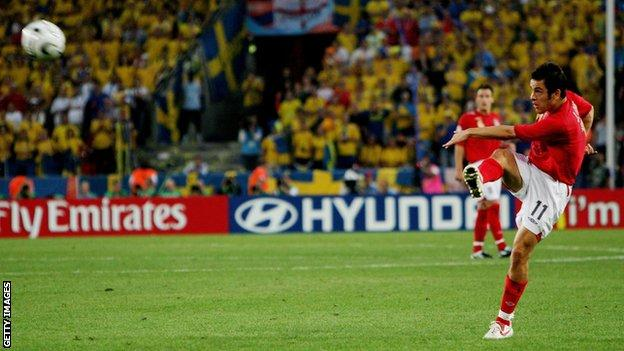 Joe Cole scores a volley for England against Sweden