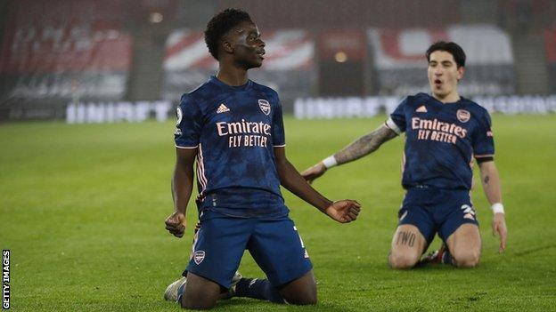 Bukayo Saka of Arsenal knee slides with team-mate Hector Bellerin after scoring against Southampton