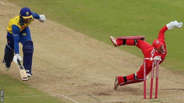 Lancashire's Alex Davies runs out Graham Clark of Durham