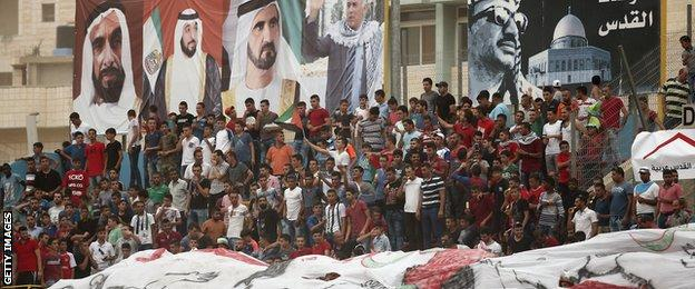 Palestine fans display political banners at their home match against UAE in September