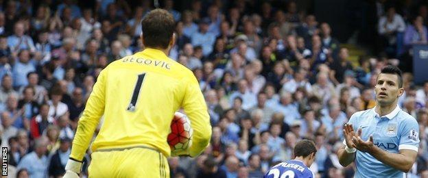 Asmir Begovic is applauded by Sergio Aguero
