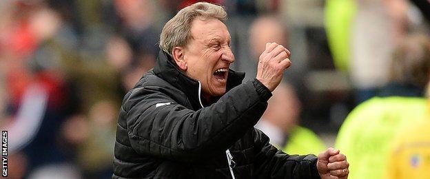 Neil Warnock celebrates with Rotherham