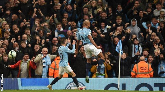 Kompany celebrates his goal against Leicester