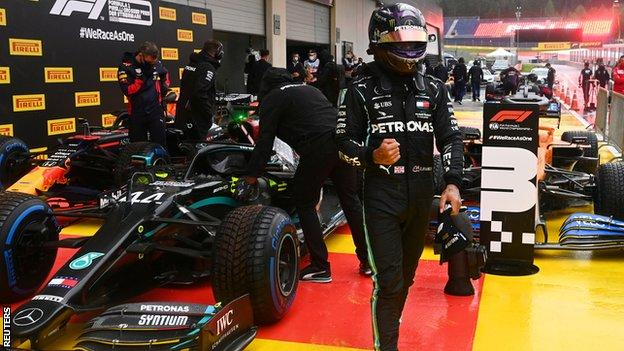 Lewis Hamilton celebrates pole position