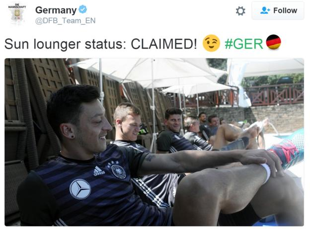 Mesut Ozil and his Germany team-mates on sun loungers by a pool