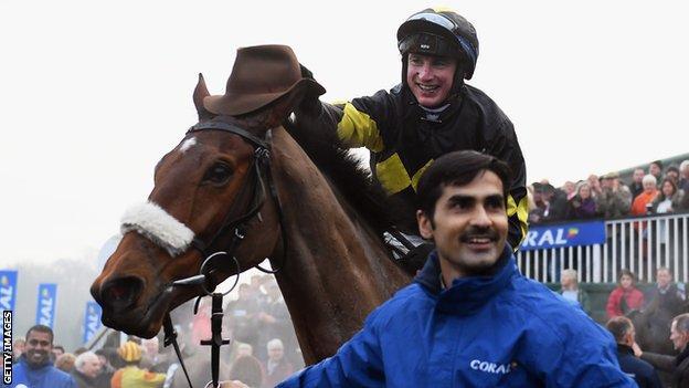 Jockey Tom O'Brien celebrates on Elegant Escape after winning the Welsh Grand National