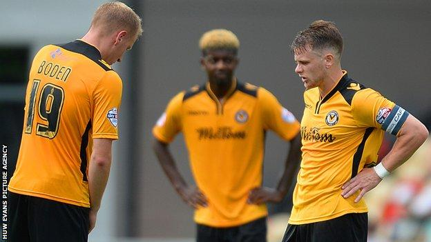 Newport players looked dejected after conceding a third against Leyton Orient