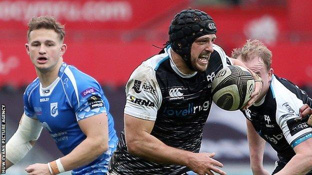 Dan Evans breaks through to score one of his four tries for Ospreys against Dragons