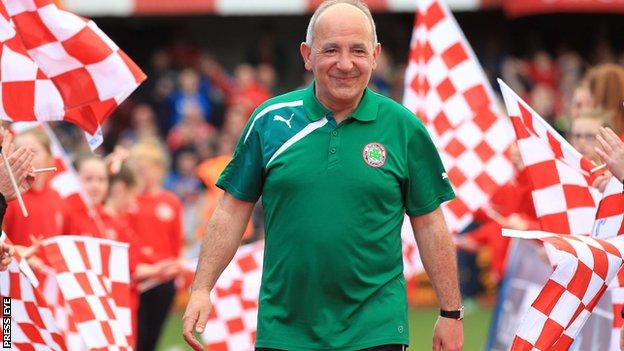 Tommy Breslin joins in with the celebrations at Solitude after guiding the Reds to the league title in 2014