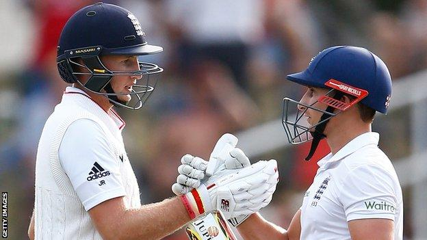 England batsman Joe Root (left) is congratulated on his fifty by James Taylor