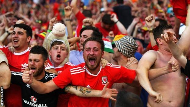 Wales fans celebrate a goal against Russia