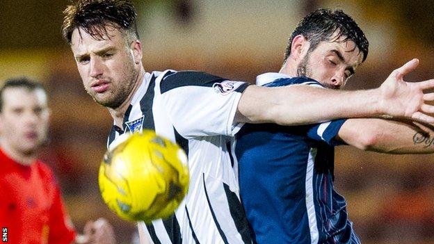 Brad McKay (left) in action for Dunfermline