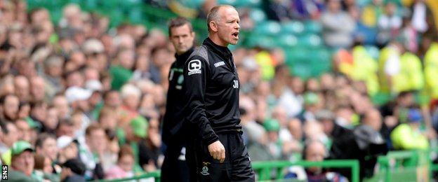 John Hughes and Ronny Deila in the Celtic Park technical areas