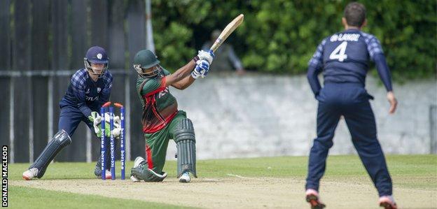 Con de Lange takes the wicket of Rakep Patel for Scotland