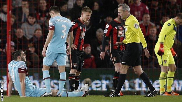 West Ham striker Andy Carroll (left)