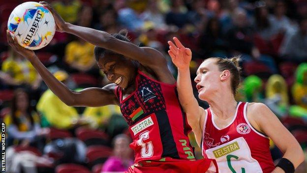Wales battle for possession against Malawi