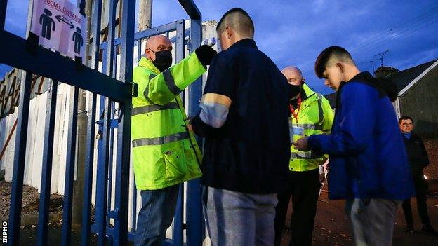 Fans attend Coleraine-Ballymena match