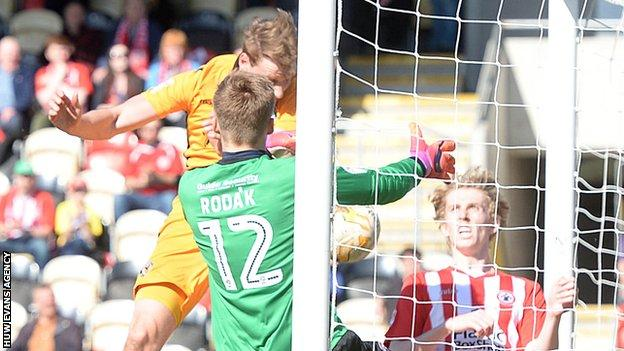 Ryan Bird bundles-in the ball for Newport County against Accrington Stanley