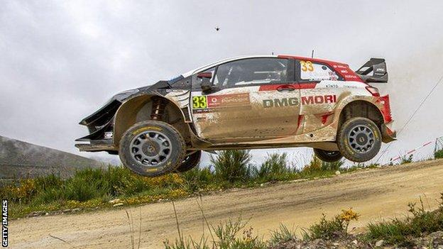 Elfyn Evans of Great Britain and  Scott Martin of Great Britain compete