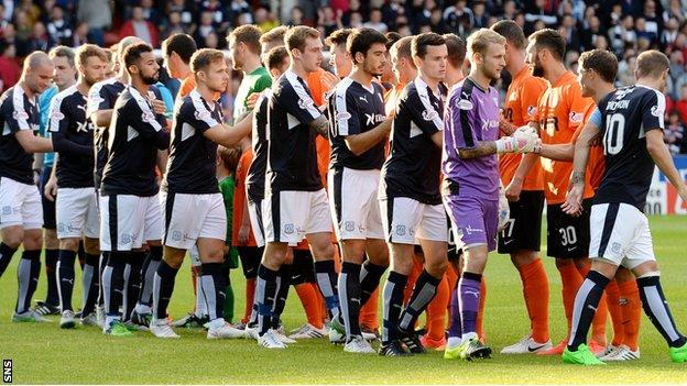 The two Dundee teams shake hands prior to kick-off