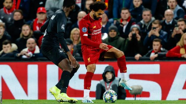 RB Salzburg's Patson Daka (left) up against Liverpool's Mohamed Salah