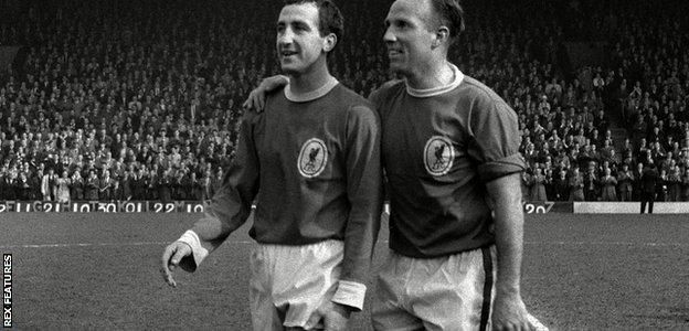 Gerry Byrne and Ronnie Moran celebrate winning the league championship in 1963-64