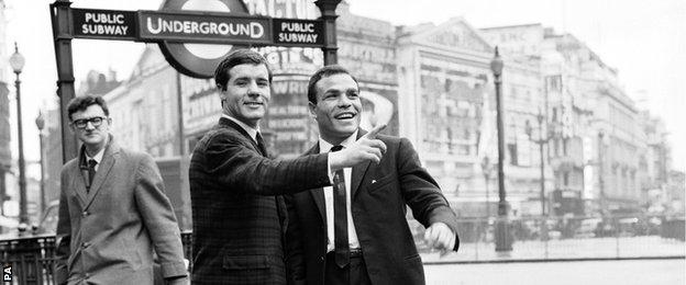 Walter McGowan (left) shows Italian Salvatore Burruni around Piccadilly after they had signed a contract to fight for the WBA world flyweight title