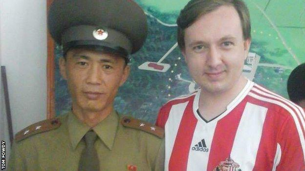 Tom Fowdy with a North Korean soldier