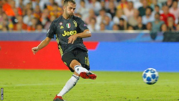 Miralem Pjanic scores a penalty for Juventus