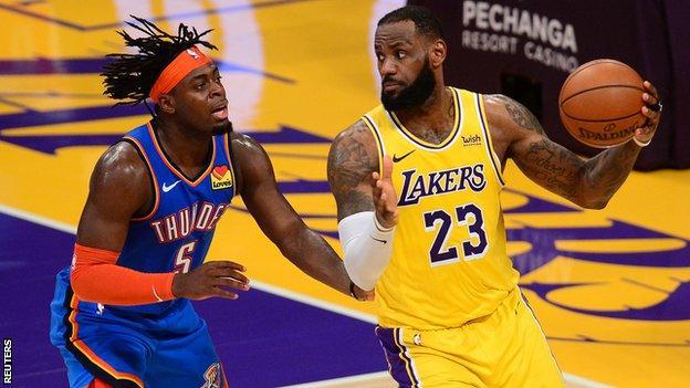Los Angeles Lakers forward LeBron James controls the ball against Oklahoma City Thunder forward Luguentz Dort
