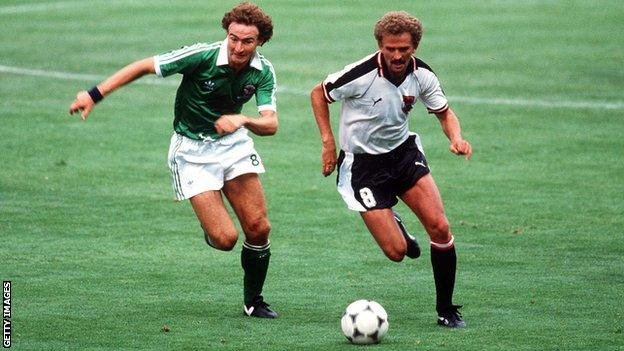 Martin O'Neill tries to keep pace with Austria's Herbert Prohaska during Northern Ireland's game with Austria at the 1982 World Cup finals