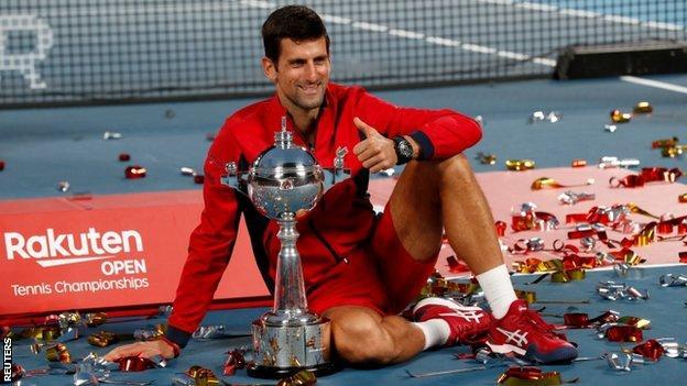 Novak Djokovic with the Japan Open trophy