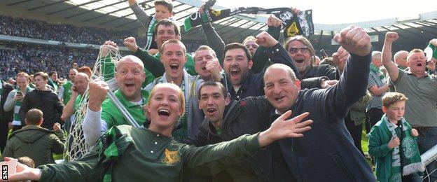 Hibs supporters celebrate victory on the Hampden pitch