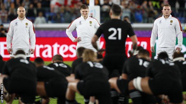 Owen Farrell smiles as New Zealand do the haka