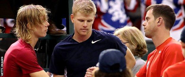 Denis Shapovalov of Canada shake hands with Great Britain coach Leon Smith and Kyle Edmund of Great Britain