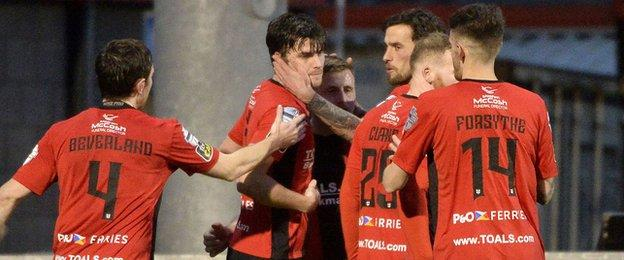 Philip Lowry scored the first as Crusaders beat Warrenpoint 3-1