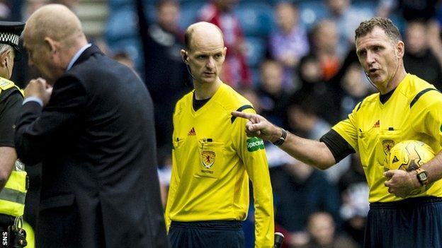 Peter Houston and referee John McKendrick
