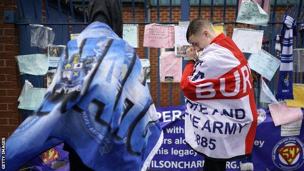 Bury fans gathered at their Gigg Lane home after they were expelled from the English Football League, but 12 months later, they are are no nearer to seeing a return to the ground