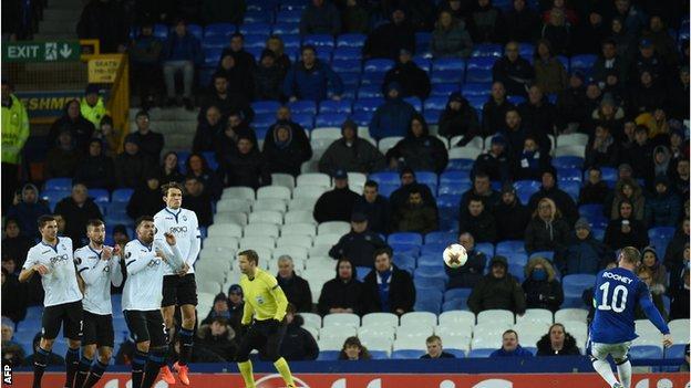 Everton captain Wayne Rooney takes a free-kick against Atalanta