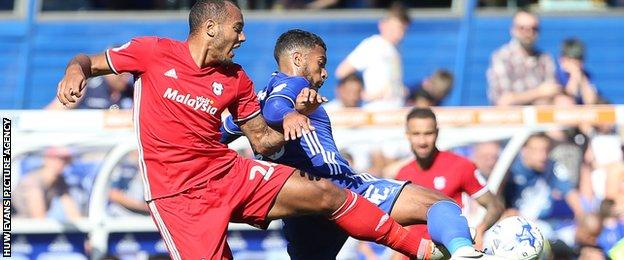 Cardiff City's Kenneth Zohore is tackled by Reece Brown