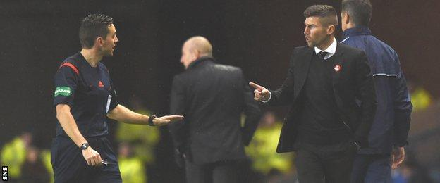 Referee Andrew Dallas and Mark Burchill exchange words at Ibrox