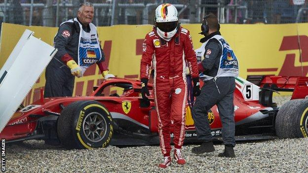 Sebastian Vettel walks away after crashing his Ferrari while leading the German Grand Prix in 2018