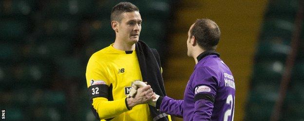 Celtic's Craig Gordon shakes hands with Kilmarnock's Jamie MacDonald