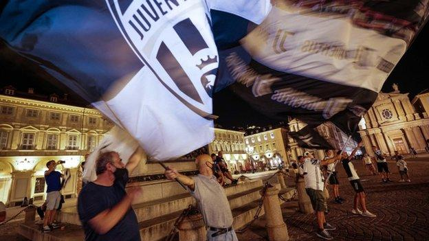 Juventus fans celebrate their title win in Turin