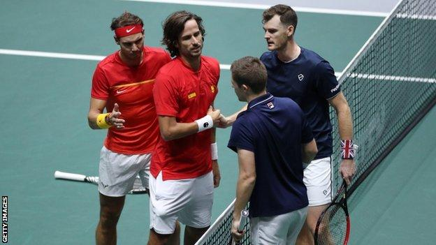 Jamie Murray and Neal Skupski shake hands with Rafael Nadal and Feliciano Lopez
