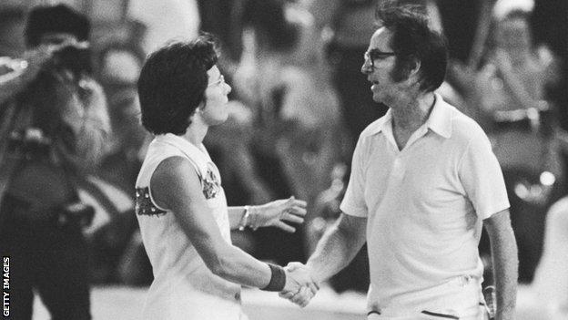 Billie Jean King shakes hands with Bobby Riggs