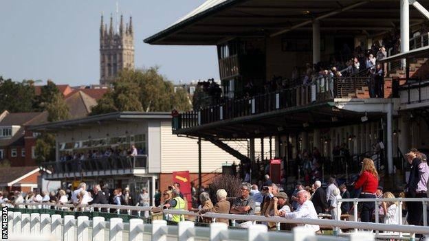 Racegoers at Warwick Racecourse