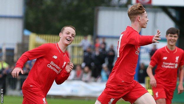 Glen McCauley celebrates after scoring Liverpool's goal against GPS FC Bayern