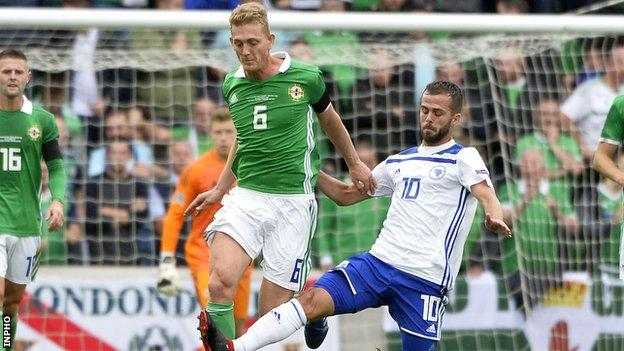 Northern Ireland's George Saville battles with Bosnia's Miralem Pjanic in Belfast last year