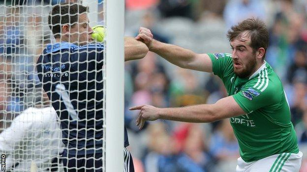 Sean Quigley pushes Stephen Cluxton over the Dublin goal-line